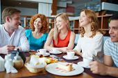 stock photo of canteen  - Group of friends drinking tea at caf - JPG