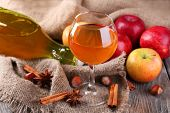 stock photo of cider apples  - Apple cider in wine glass and bottle - JPG