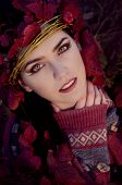 image of pixie  - beautiful brunette in autumn red leaves looking like pixie - JPG