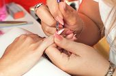 picture of nail paint  - Manicure process in beauty salon showing making of beautiful artificil nails - JPG