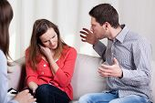 stock photo of wifes  - Screaming husband and his wife during psychotherapy - JPG