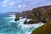 foto of windy weather  - Coastline of Mizen Head in stormy weather - JPG