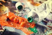 image of paint palette  - Professional acrylics paints in tubes on a painter palette - JPG