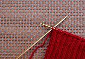 image of knitting  - Handmade maroon knitting yarn with knitting needles - JPG