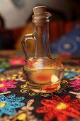 image of vinegar  - Decanter of vinegar flavored with herbs in the uzbek restaurant - JPG