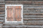 stock photo of chalet  - Closed shutters on a wooden chalet worn by the snow - JPG