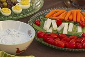 stock photo of kalamata olives  - Deviled eggs kalamata and green olives served with carrots jimaca and cherry tomatoes as a before dinner horderve  - JPG