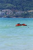 stock photo of jet-ski  - Jet Ski Moored in the sea of Patong beach - JPG