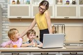 stock photo of morning  - Young business woman early in the morning with her little children - JPG