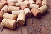 stock photo of bing  - Wine corks on rustic wooden table background - JPG