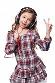 picture of singing  - Pretty little girl singing in imaginary microphone with headphones on his head isolated over white - JPG
