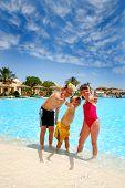 foto of summer fun  - Three smiling kids have fun at pool - JPG