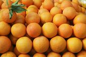 stock photo of valencia-orange  - Valencia oranges stacked on market in mediterranean spain - JPG