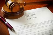 stock photo of contract  - a legal gavel and a business contract - JPG