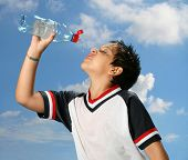 Thirsty Boy Drinking Water Outdoors poster