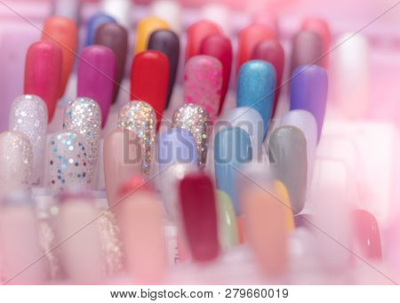 poster of Colorful Artificial Nails In Nail Salon Shop. Set Of False Nails For Customer To Choose Color For Ma