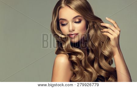 Laughing Blonde Girl With Long  And   Shiny Wavy Hair .  Beautiful  Smiling Woman Model With Curly H poster