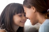 Smiling Little Child Girl Tenderly Touching Foreheads With Happy poster