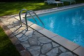 Swimming pool in residence garden poster