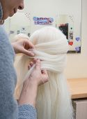 Training Braiding Braids On The Head Of The Dummy poster