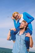Man Carries Girlfriend On Shoulders, Sky Background. Woman Enjoy Perfect Romantic Date. Couple In Lo poster