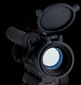 stock photo of sub-machine-gun  - red dot scope for assault rifle on black - JPG