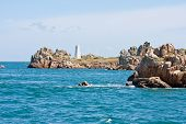 Rocky Coast With Landmark In Brittany, France poster