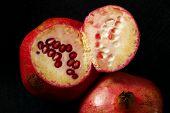 Pomegranate Fruit On Black Background, 3 Pomegranates On Black Background poster