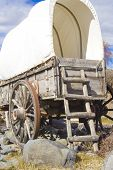 stock photo of covered wagon  - A rear view of a covered wagon used on the Old Oregon Trail - JPG