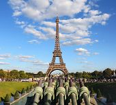Eiffel Tower With Cloud In Paris In France Seen From The Trocadero With Cannons poster