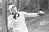Sharpen Defending Skill. Sportsman Concentrated Training Boxing Gloves. Athlete Concentrated Face Sp poster