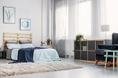 Warm White Carpet On The Floor Of Elegant Bedroom With Double Bed With Wooden Headboard And Blue Bla poster