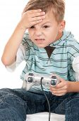 Unhappy little Boy Playing Video Games. Upset Child using video game Controller. Sad Kid with Joysti poster
