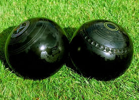 stock photo of crown green bowls  - Bowls kiss in crown green bowling tournament  - JPG