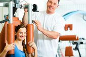 stock photo of physical exercise  - Patient at the physiotherapy making physical exercises with her therapist - JPG
