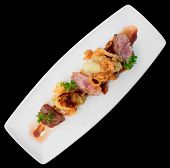 stock photo of duck breast  - Medium rare fried duck breast in plate isolated on black  - JPG