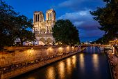 stock photo of notre dame  - Notre Dame de Paris Cathedral and Seine River in the Evening Paris France - JPG