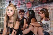 foto of peer-pressure  - Girls ignoring sad blond young woman outside - JPG