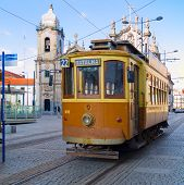 stock photo of tram  - old tram of Porto in the middle of old town district - JPG