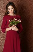 Elegant sensual young woman in claret dress