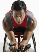foto of paralympics  - Closeup portrait of a paraplegic cycler against white background - JPG