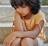 stock photo of poverty  - Poverty and poorness on the expression of children - JPG