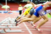 foto of race track  - Image of 100 meters athletes at the starting block with intentional blurring.