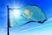 foto of flag pole  - Kazakhstan flag waving on the wind on the sky - JPG