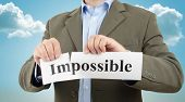 foto of pep talk  - making the impossible possible business motivation sign - JPG