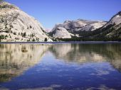 stock photo of polly  - Lake Tenaya in Yosemite National Park with Polly Dome on the left and Piwiak Dome in the center reflecting off the water - JPG