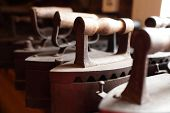 foto of charcoal  - Group of vintage charcoal flatiron in the antique store