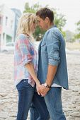 image of hand kiss  - Hip young couple about to kiss on a sunny day in the city - JPG