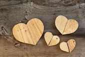 foto of elm  - Four Love Valentines wooden hearts from recycled old palette on old grey Elm background copy space - JPG