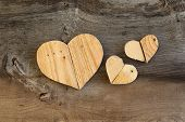 stock photo of elm  - Three Love Valentines wooden hearts from recycled old palette on old grey Elm background copy space - JPG